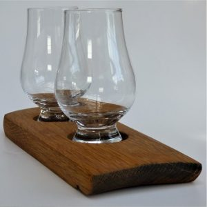 Two glasses on an oak whisky barrel plank